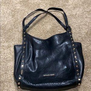 Black michael kors shoulder bag.